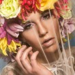 Sensual woman wearing flowers — Stock Photo