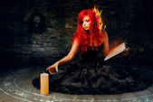 Sorceress trying to create fire — Stock Photo