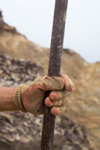 Hand and chisel — Stock Photo