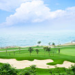 Stock Photo: Golf course and sea