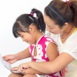 Mother read with daughter — Stock Photo