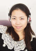 Girl wearing headphones — Stock Photo