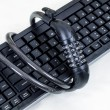 Stock Photo: Keyboard and chains