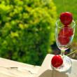 Ripe Red Cherries Stacked in a Mini Wine Glass — Stock Photo #15703853