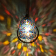 Stock Photo: Lamp Lights in Rainbow Sconce on Wall