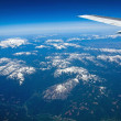 View of a Snow-capped Mountain Landscape from an Airplane — Stock Photo
