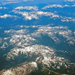 View of a Snow-capped Mountain Landscape from an Airplane — Stockfoto