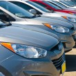 Stock Photo: Row of Automobiles on Car Lot on Bright Sunny Day