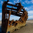 Rusty Wreckage of a Ship on a Beach on the Oregon Coast USA — Stock Photo