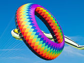 Colorful Ring Kite Flying in a Bright Blue Sky at the Long Beach Kite Festival — Stock Photo