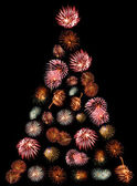 A Christmas Tree Made of Firework Bursts on a Black Background — Stock Photo