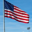 American Flag Waving Proudly on a Clear Windy Day at a Stadium — Stock Photo