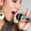 Stock Photo: Karaoke Singer