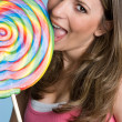 Girl Licking Lollipop — Stock Photo