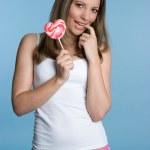 Girl Holding Heart Shaped Lollipop — Stock Photo