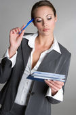 Businesswoman Writing Check — Stock Photo
