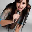 Stock Photo: Beautiful Singing AsiGirl