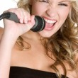 Stock Photo: Young Singing Girl