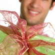 Handsome man with  present — Stock Photo