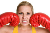 Portrait of young woman with boxing gloves — Stock Photo