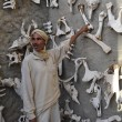 Stock Photo: Berber in Saharat zoo shows animal bones. Tunis.