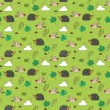 Vector green seamless pattern with hedgehogs, mushrooms, birds and leaves — Stock Vector
