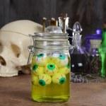 Jar of eyeballs skull and potions — Stock Photo #12245110