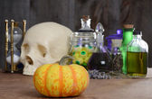 Halloween still life with pumpkin and potions — Stock Photo