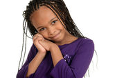 Cute african child with purple top — Stock Photo