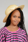 Young african girl wearing a straw hat — Stock Photo