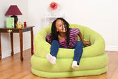 Young black child trying to get out of chair — Stock Photo