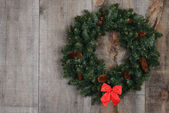 Christmas wreath with red bow — Stock Photo
