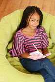 Top view young girl writing in diary — Stock Photo