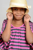 Young black child silly with hat — Stock Photo