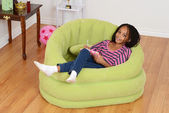 Happy young black child relaxing — Стоковое фото