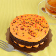 Orange chocolate cake with tea — Stock Photo