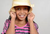 African Girl being silly with hat — Stock Photo