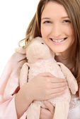 Teen girl hugging toy lamb — Stock Photo