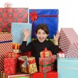 Excited little girl with christmas presents — ストック写真
