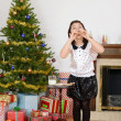Little girl eating santa cookies — Stockfoto