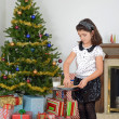 Little girl putting out cookies milk for santa — Foto de Stock