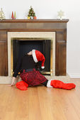 Child looking up fireplace for santa — Stock Photo