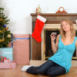 Woman relaxing with glass wine at christmas — Stockfoto