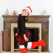 Young girl dancing in front of fireplace — Stock Photo #16313833