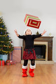 Child catching christmas present — Stock Photo