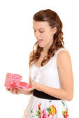 Teen girl surprised with valentines gift — Stock Photo