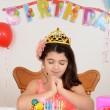 Little girl making birthday wish — Stock Photo