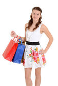 Happy teen girl with shopping bags — Stock Photo