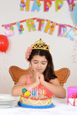 Little girl making birthday wish — Stock Photo