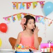 Birthday girl licking her fingers — Stock Photo